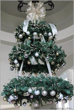 Hanging Christmas Tree - WREATH CHANDELIER ~ This would be so pretty in the entryway! this would make a very pretty outdoor tree for our porch Hanging Christmas Tree, Noel Christmas, Christmas Wreaths, Christmas Chandelier Decor, Chandelier Tree, Outdoor Christmas, Christmas 2019, Christmas Tree Cat Proof, Rustic Christmas