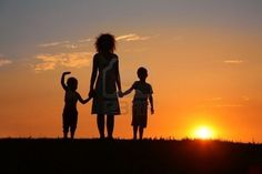 Mother and children at sunset