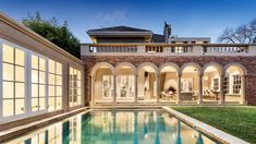 A striking Toorak mansion restored by murdered interior designer Stuart Rattle is turning heads with a massive asking price for the picture perfect property. Mansion Plans, Melbourne Markets, Dining Room Fireplace, Huge Kitchen, Mega Mansions, Amazing Houses, Walk In Pantry, Cabana, Ground Floor