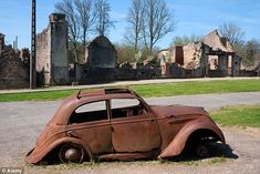 Today Oradour exists as a massive memorial - a chilling time capsule where the burned out homes remain exactly as they were on the day they were torched, and even the car of the mayor still lies rusting in the main street