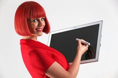 This short haired redhead in red is Miss IFA 2013 for the Berlin Technology Festival / Trade Show in September this autumn. Expect to see a lot of new tech, tablets, and smartphone stuff. Here this woman is seen with a Panasonic tablet.