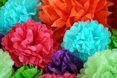How to make easy tissue paper flowers. Awesome for putting on gifts or using as a garland!