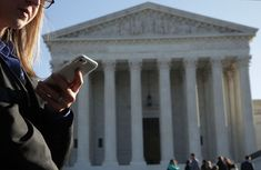 A woman checks her cellphone as she waits in line to enter the u. supreme court to view a hearing on november alex wong/getty images Peoples Bank, Alex Wong, State Court, Government Shutdown, Tax Refund, Instagram Influencer, Health Lessons, Living At Home, Supreme Court