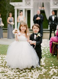 #FlowerGirl #RingBearer | See the wedding on #SMP:  http://www.stylemepretty.com/2013/12/12/traditional-charleston-wedding/ KT Merry Photography