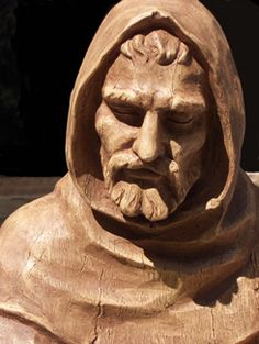 Saint Francis of Assisi, the patron saint of animals and the environment. Sculpture Head, Wood Sculpture, Sculptures, Tree Carving, Wood Carving, St Francis Statue, Dog Garden Statues, Patron Saint Of Animals, Life Size Statues