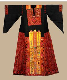 Al Khalil (Hebron) region dresses are festive and richly embroidered in cross-stitch embroidery on black or dark blue hand woven fabric