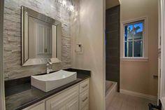 Contemporary Full Bathroom with Built-in bookshelf, Absolute Black Granite Countertop, Stonemark Granite, High ceiling
