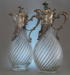 A phenomenon in the Victorian & Edwardian age, a pair of cut glass & antique silver Claret Jug wine decanters!