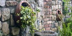 plant-vessels or-similar-peppers-the-wall-still-on. 425 x 215 (@ Steep Gardens, Back Gardens, Brick Wall Decor, Garden Deco, Garden Pictures, Brick And Stone, Stone Flooring, Cool Walls, Garden Styles