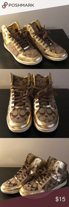 Women's Coach Fashion Sneakers Women's Coach Signature logo Sneakers in gold. Style is Norra. Sneakers are high top (above ankle). Size 8 and they do run big (I'm normally between 8.5 and 9 and sneakers fit me perfectly). They are a few scuffs throughout sneakers (see photos) and they need a bit of deep cleaning around the sole. Coach Shoes Sneakers