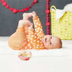 An absolute must-have for baby's first wardrobe, the Pop Prints collection Long Sleeve Bodysuit is the perfect foundation piece. Paired with our Baby Pant, this ultra-soft essential is ideal for everyday adventures. Also includes an adorable color coordinated soft rattle.<br><ul><li>3 piece set</li><br><li>Includes bodysuit, pant and rattle</li><br><li>100% cotton</li><br><li>Imported</li></ul>