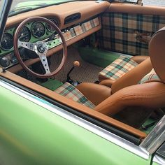 Green Porsche 911 with #tartan upholstered seats