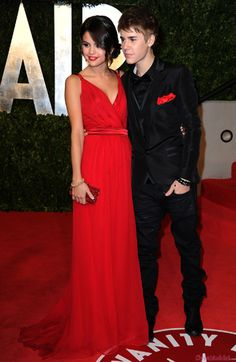 Perfect. All black tux and a stunning red dress...perfect