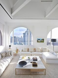 love the all white and natural light emphasis. Brings the laid back suburbs into the home in the city!