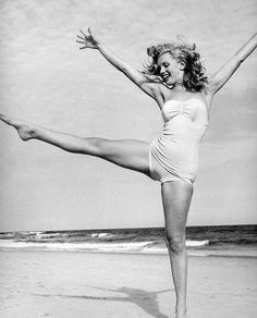 Cool shot of Marilyn Monroe dancing on the beach. Captures a mood.