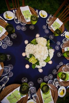 Wedding Color: Green. Colored glassware is an elegant way to add pop to your table in your hue of choice.