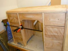completely sanded and new sides were added, drawers were shimmed to glide better