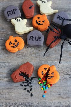 Trick or Treat Cookies: Not Martha's trick-or-treat cookies are twice the fun. Outside, they look like simple Halloween cookies shaped like pumpkins, coffins, gravestones, and ghosts, but inside they're stuffed with treats (mini chocolate candies) or tricks (small sugar ants).  Source: Not Martha