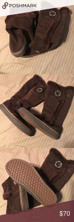 Vans Boots Brown Vans boots size 5.5. They have been in storage so there is some hair on them (they will be cleaned before being sent out) but in very good condition. They are super warm and cozy. They Velcro close with a button to secure. I don't believe they even make these anymore. I love them but they just don't get worn. Vans Shoes Winter & Rain Boots