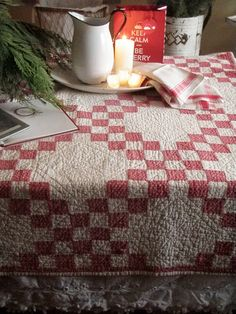 Antique Red Checked Farmhouse Quilt with White Enamelware Pitcher