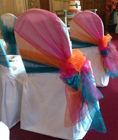 Teal, Pink, Orange Organza sashes on white cotton chair covers from Simply Bows and Chair Covers at Mill Hall Greenham