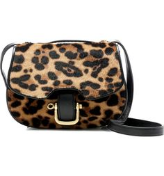 Absolutely adoring this equestrian-inspired bag crafted of Italian leather with leopard-printed calf hair. With an adjustable strap—converting it to a crossbody, shoulder bag or handbag—it offers many smart ways to carry things around for fall.