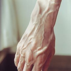 "RINKO KAWAUCHI// Untitled, from the series ""Utatane"" (うたたね), 2001. I really love the detail of this image! once again Kawauchi has used light to create shadows on the hand, giving this image a lot of depth."
