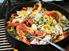 Easy Grilled Paella | To cook this delicious seafood-and-chorizo paella, chef Pete Evans uses his grill as both a stovetop and an oven, simultaneously using direct and indirect heat.