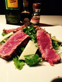 sliced fillet of beef with parmesan cheese and rocket, simple and tasty, crunchy yet juicy