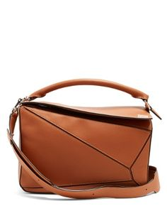 Loewe's Puzzle bag was the first designed by Jonathan Anderson and has fast become a covetable signature style. This tan-brown version is crafted from lightly grained leather with hand-painted edges and two interior pockets for optimal organisation. Wear it one of five ways to suit your look.