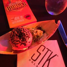 First Burger of the night the Rockin' Burger Block Party! #Stk #epcotfoodfestival #epcotfoodandwine #rockinburgerblockparty #burger #party #Disney #Epcot