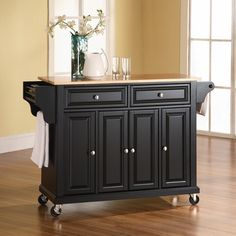 Crosley KF30001EBK Natural Wood Top Kitchen Cart/Island in Black FinishConstructed of solid hardwood and wood veneers, this kitchen island is designed for longevity. The beautiful raised panel doors and drawer fronts provide the ultimate in style to dress up your kitchen. Two deep drawers are great for anything from utensils to storage containers. Behind the four doors, you will find adjustable shelves and an abundance of storage space for things that you prefer to be out of sight. Style…