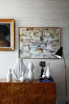 love the soft palette of the artwork and neutral wallpaper design by jonathan adler