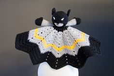 You can use what ever nice pattern you'll find for the blanket. I used Sunburst Baby Blanket. In this pattern, you'll find instructions for the amigurumi Batman. Crochet Lovey, Crochet Hooks, Free Crochet, Crochet Batman, Baby Batman, Lovey Blanket, Security Blanket, Crochet Patterns, Blanket Patterns