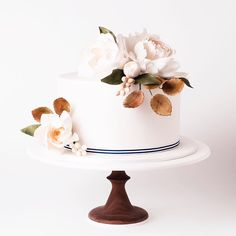 white wedding cake with floral topper ~  we ❤ this! moncheribridals.com