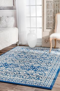 Add a touch of elegance and grace to your living space with this indoor, floral, machine made rug. This rug is made out of 100% polypropylene and comes in a variety of shapes to brighten up any room instantly.