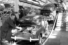 Austin Seven assembly line at the Longbridge Plant, Birmingham, England. In the background the Austin A40 production line.