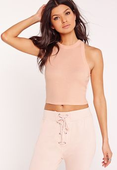Go back to basics with this dreamy nude crop top! With a fierce racer style neckline, figure-flattering fabric and cropped style, this sleeveless beaut is top of our lust have list! Team up with high waisted jeans and trainers for casual da...