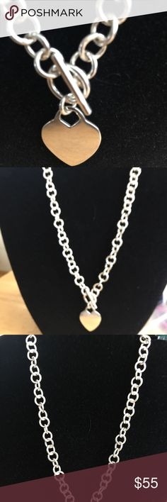Sterling silver necklace.  Toggle, heart attached Very simple but great for any occasion.  Perfect for a gift for the silver lover.    Great to tell someone I love you.  Heart is engrave able.  I have three initials on mine but you can write anything.  Mine also says I love you mommy and the date.  Great little reminder. Limor Jewelers Jewelry Necklaces