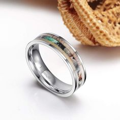 The ring is made of lighter, weightless high-tech titanium than stainless steel and tungsten. the deer antler and camo inlay is the perfect backdrop for the ring, which comes in a choice of and Unique Wedding Bands, Wedding Rings, Titanium Rings, Tungsten Rings, Fashion Rings, Fashion Jewelry, Deer Antlers, Camo, Rings For Men