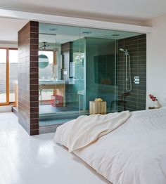 Modern Chic Master Suite''s Unique floorplan. Creative use of space to be able to have the natural light & windows seen from the bedroom by keeping the bathroom visually open with the glass walls of the shower, etc.