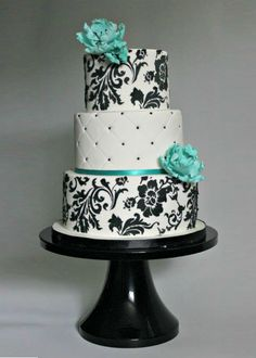 elegant and modern wedding cake Could use and color flowers and ribbon to match the wedding
