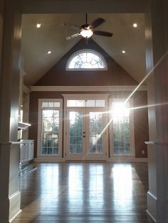 Love everything about this great room: vaulted ceiling, hardwood floors, lots of windows  by FayNewHomes, via Flickr