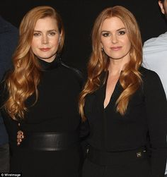 Double take! Australian actress Isla Fisher has taken things to the next level by cheekily editing her family Christmas card to feature Amy Adams' face