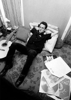300 GREAT ALBUMS That Will Change Your Life!:___ ⬤ Joe Strummer of The Clash listening to vinyl records.___ ➜ Click the pic to hear the MUSIC PLAYER!