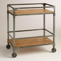 Bring an industrial-chic feel to your kitchen or home bar with this stylish bar cart, made of rustic metal and mango wood. >> #WorldMarket Urban Industrial