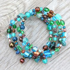 'Neptune's treasure' teal, turquoise and brown glass bead memory wire bracelet - - SOLD Beaded Wrap Bracelets, Unique Bracelets, Handmade Bracelets, Jewelry Bracelets, Jewellery, Memory Wire Jewelry, Memory Wire Bracelets, Stone Beads, Glass Beads