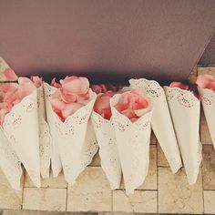 Cones hold rose petals for guests to toss after the ceremony