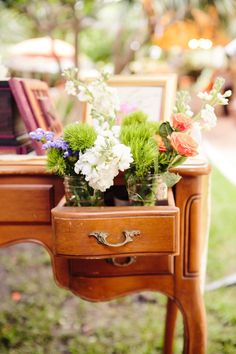 Pull drawers out with flowers! perfect if you use a desk for your guest book, or gift table or whatever!