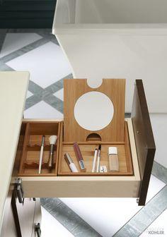Amazing makeup storage in the Kohler Poplin bathroom vanity.
